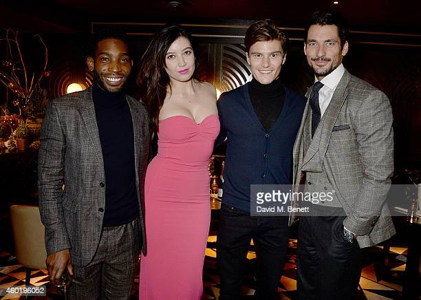 Tinie Tempah Daisy Lowe Oliver Cheshire and David Gandy attend the GQ Christmas Lunch at Quaglino's on December 9 2014 in London England