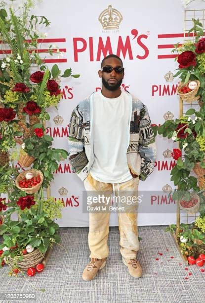 Tinie Tempah enjoys PIMM'S No 1 hospitality at The Championships, Wimbledon on July 1, 2021 in London, England.