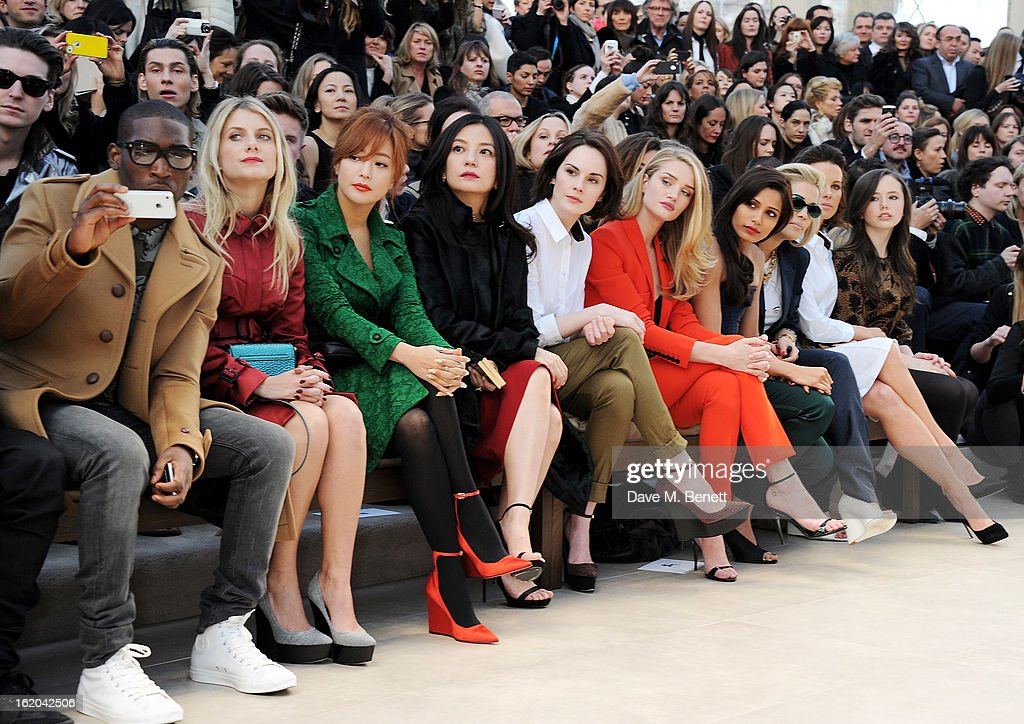 Tinie Tempah, Melanie Laurent, Kim Hee-sun, Vicki Zhao, Michelle Dockery, Rosie Huntington-Whiteley, Freida Pinto, Rita Ora, Kate Beckinsale and Lily Mo Sheen sit in the front row for the Burberry Prorsum Autumn Winter 2013 Womenswear Show at Kensington Gardens on February 18, 2013 in London, England.