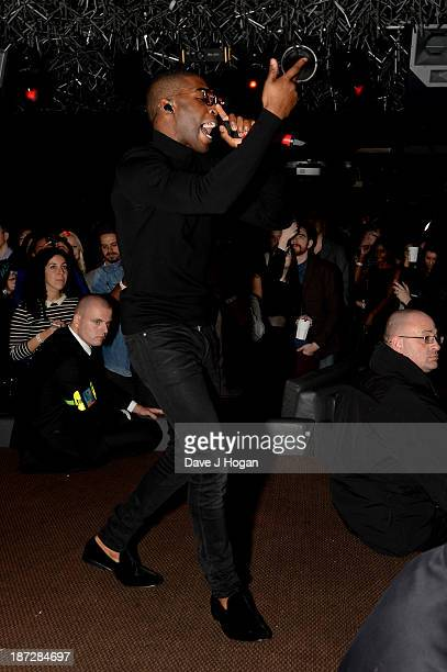 Tinie Tempah performs during the Beats by Dre present Tinie Tempah's album launch party at DSTRKT on November 7 2013 in London England Demonstration...