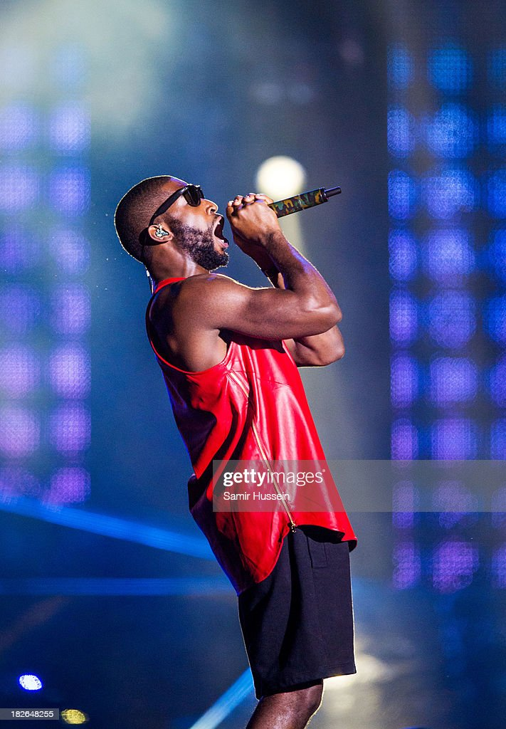 Tinie Tempah performs live on stage at the Unity concert in memory of Stephen Lawrence at O2 Arena on September 29, 2013 in London, England.