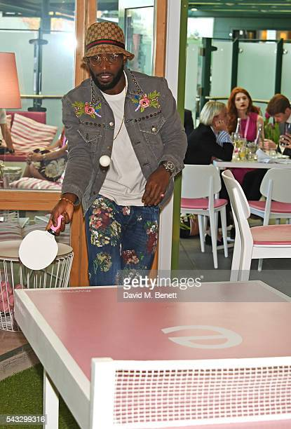 Tinie Tempah plays ping pong in the evian Live Young suite during Wimbledon 2016 at the All England Tennis and Croquet Club on June 27, 2016 in...