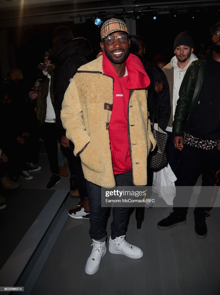 Tinie Tempah poses on the front row at the A-COLD-WALL show during London Fashion Week Men's January 2018 at BFC Show Space on January 8, 2018 in London, England.