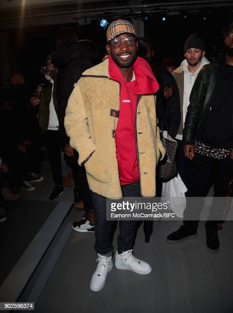 Tinie Tempah poses on the front row at the ACOLDWALL show during London Fashion Week Men's January 2018 at BFC Show Space on January 8 2018 in London...