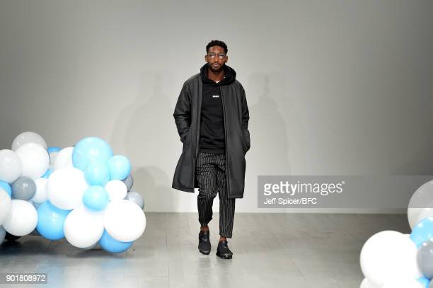 Tinie Tempah walks the runway at the What We Wear show during London Fashion Week Men's January 2018 at BFC Show Space on January 6, 2018 in London,...