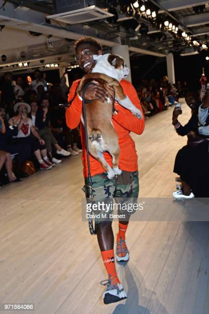 Tinie Tempah walks the runway with dog Pablo at the What We Wear show during London Fashion Week Men's June 2018 at the BFC Show Space on June 11...