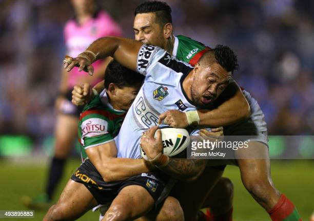 Tinirau Arona of the Sharks is tackled by Kyle Turner and John Sutton during the round 11 NRL match between the Cronulla-Sutherland Sharks and the...