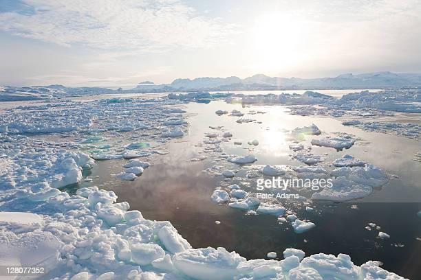 tiniteqilaaq and sea ice in winter, e. greenland - 東 ストックフォトと画像