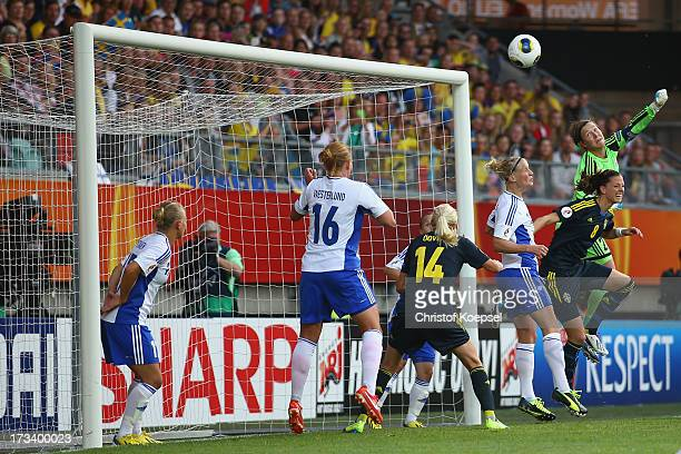 TinjaRiikka Korpela of Finland saves the ball against Lotta Schelin of Sweden during the UEFA Women's EURO 2013 Group A match between Finland and...