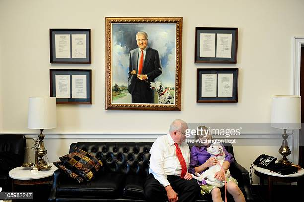 Tinker a female sevenishmonthold dalmatian mix is cradled by Rep Jim Sensenbrenner and his wife Cheryl in his office in Washington DC on May 25 2010...
