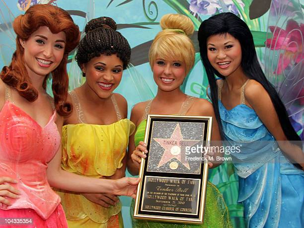 Tinker Bell and her guest pose for photographers during the installation ceremony on the Hollywood Walk of Fame on September 21 2010 in Hollywood...
