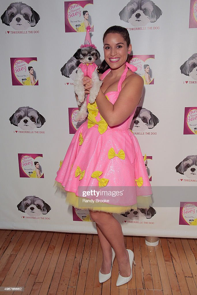 Tinkerbelle and Actress and Singer Gina Naomi Baez pose during the Andi Dorfman Celebrates Tinkerbelle The Dog's Birthday at Inglot Cosmetics on November 11, 2015 in New York City.