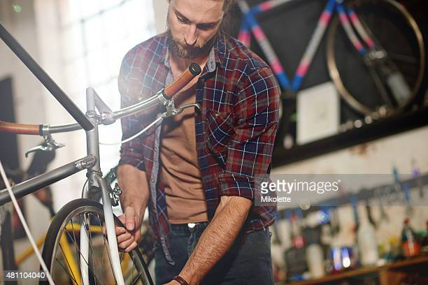 Tinkering away with his bicycles