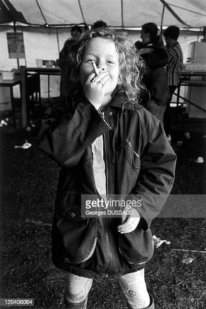 Tinkers in Letterkenny Ireland in May 1995 Donegal County Letterkenny Tinkers little girl smoking a cigarette