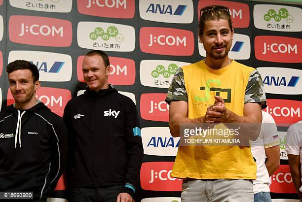 Tinkoff team cyclist Peter Sagan of Slovakia smiles after a photo session with 2016 Tour de France cycling road race winner Christopher Froome of...