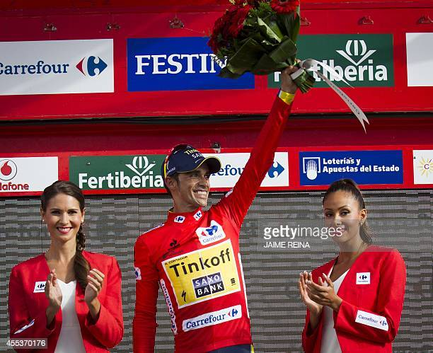 Tinkoff's Spanish cyclist Alberto Contador celebrates retaining the red jersey on the podium following the 20th stage of the 69th edition of 'La...