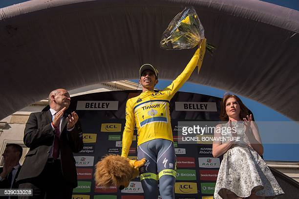 Tinkoff's Spanish rider Alberto Contador celebrates his overall leader's yellow jersey on the podium after the fifth stage of the 68th edition of the...
