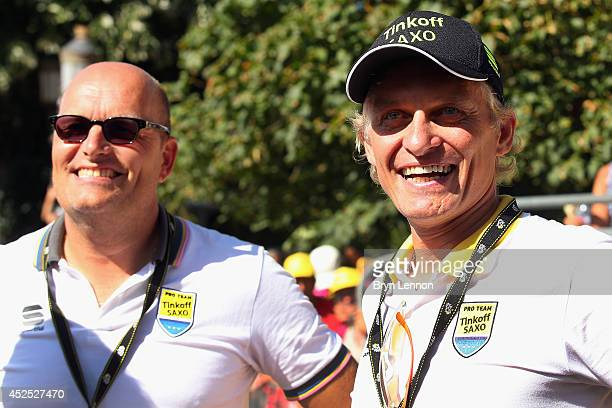 Tinkoff-SaxoTeam Manager Bjarne Riis and Team Owner Oleg Tinkoff watch the podium ceremony during the sixteenth stage of the 2014 Tour de France, a...