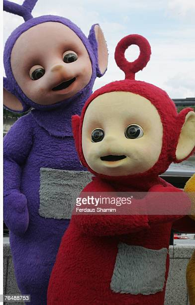 Tinky Winky and Po pose at the Teletubbies 10th anniversary celebration September 3 2007 in LondonEngland