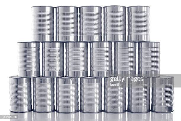 tinned food: generic steel tin cans stacked in rows - canned food stock pictures, royalty-free photos & images