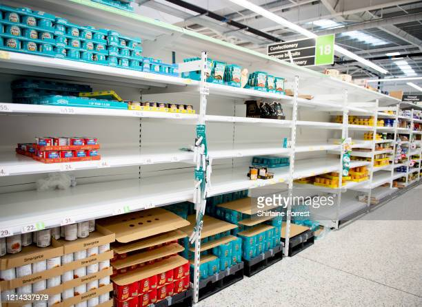 Tinned pasta is sold out in Asda on March 23, 2020 in Altrincham, England. Coronavirus pandemic has spread to at least 182 countries, claiming over...