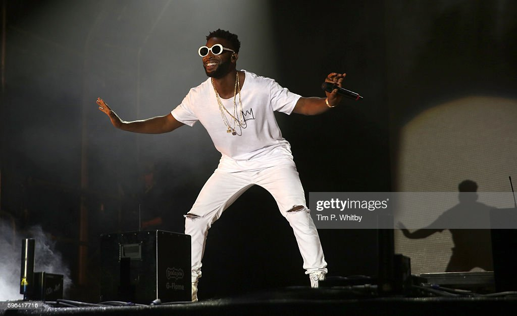 Tinnie Tempah performs on the main stage on day two of The Big Feastival at Alex James' Farm on August 27, 2016 in Kingham, Oxfordshire.
