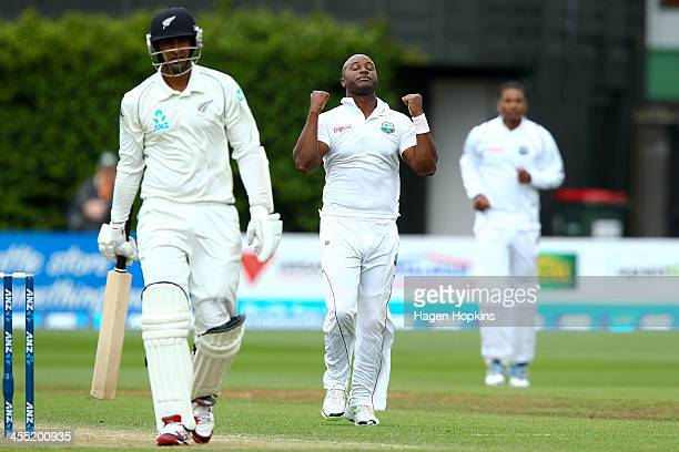 Tino Best of the West Indies celebrates after taking the wicket of Ish Sodhi of New Zealand during day two of the Second Test match between New...