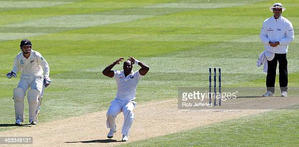 Tino Best of the West Indies reacts after seeing a dropped catch off his bowling during day two of the first test match between New Zealand and the...