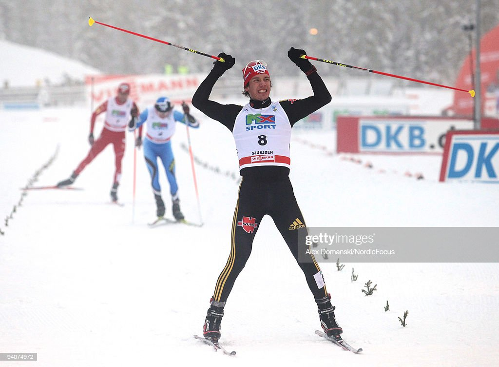 Tino Edelmann of Germany celebrates after winning the Gundersen 10km event during day two of the FIS Nordic Combined World Cup on December 6, 2009 in Lillehammer, Norway.