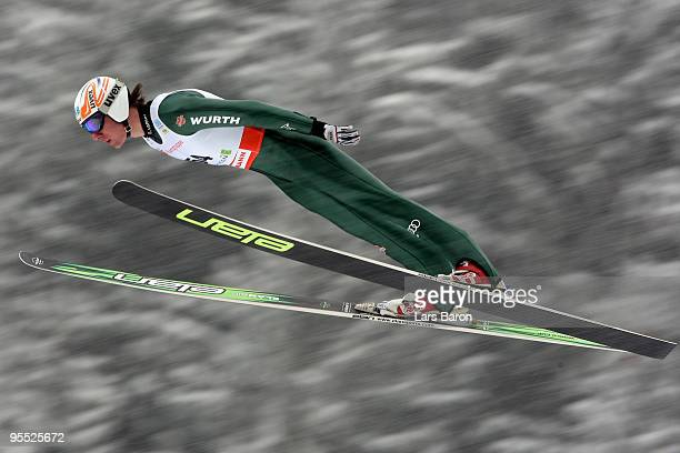 Tino Edelmann of Germany competes during the Ski Jumping event of the FIS Nordic Combined World Cup at the Hans-Renner-Schanze on January 2, 2010 in...