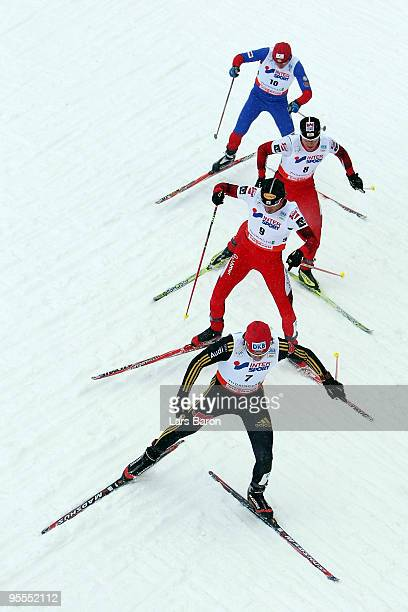 Tino Edelmann of Germany competes infront of Christoph Bieler of Austria Bernhard Gruber of Austria and Pavel Churavy of Czech Republic during the...