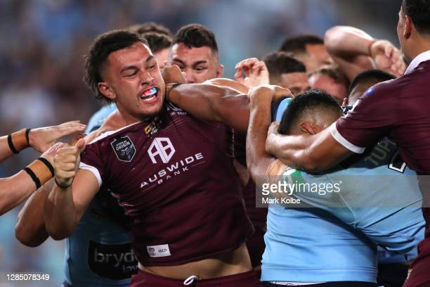 Tino Fa'asuamaleaui of the Maroons and Payne Haas of the Blues scuffle during game two of the 2020 State of Origin series between the New South Wales...