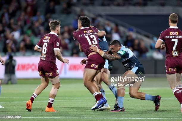 Tino Faasuamaleaui of the QLD Maroons tackled during game one of the 2020 State of Origin series between the Queensland Maroons and New South Wales...