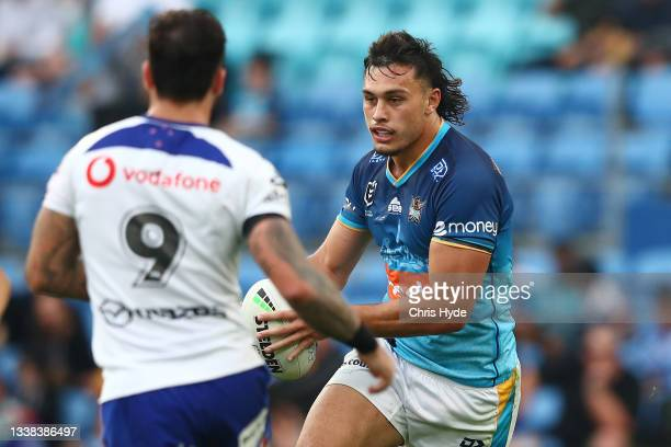Tino Fa'asuamaleaui of the Titans runs the ball during the round 25 NRL match between the Gold Coast Titans and the New Zealand Warriors at Cbus...