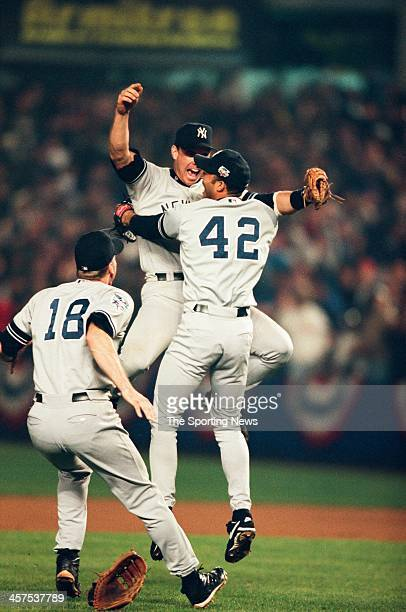 Tino Martinez and Mariano Rivera of the New York Yankees celebrate following Game Five of the World Series against the New York Mets on October 26...