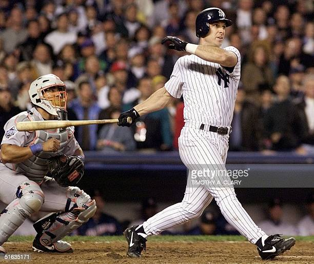 Tino Martinez of the New York Yankees and catcher Carlos Hernandez of the San Diego Padres watches Martinez's seventh inning gland slam home run 17...