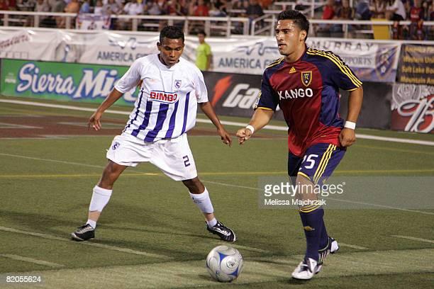 Tino Nunez of Real Salt Lake kicks the ball against Yader Balladarez of Deportivo Saprissa at Rice Eccles Stadium on July 23 2008 in Salt Lake City...