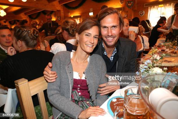 Tino Schuster and his grilfriend Carolin Pohl during the 'Fruehstueck bei Tiffany' at Schuetzenfesthalle at the Oktoberfest on September 16, 2017 in...
