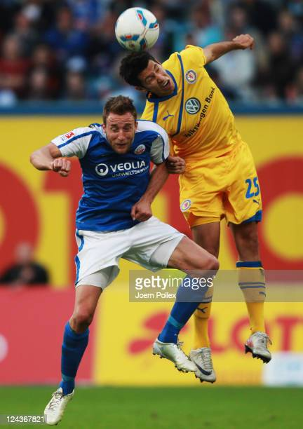 Tino Semmer of Rostock and Marcel Correia of Braunschweig battle for the ball during the Second Bundesliga match between FC Hansa Rostock and...