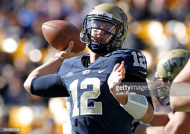 Tino Sunseri of the Pittsburgh Panthers drops back to pass against the Louisville Cardinals during the game on October 13 2012 at Heinz Field in...