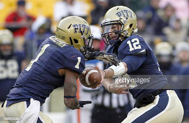 Tino Sunseri of the Pittsburgh Panthers hands the ball off to Ray Graham against the Rutgers Scarlet Knights during the game on November 24 2012 at...