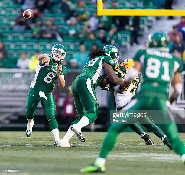 Tino Sunseri of the Saskatchewan Roughriders looks downfield for Chaz Schilens of the Saskatchewan Roughriders during a preseason game between the...