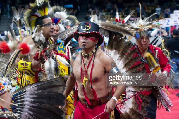 Tino Trujillo of the Mescalero Apache Nation dances during the Grand Entry of the Denver March Powwow on March 24 2017 in Denver Colorado Held over...