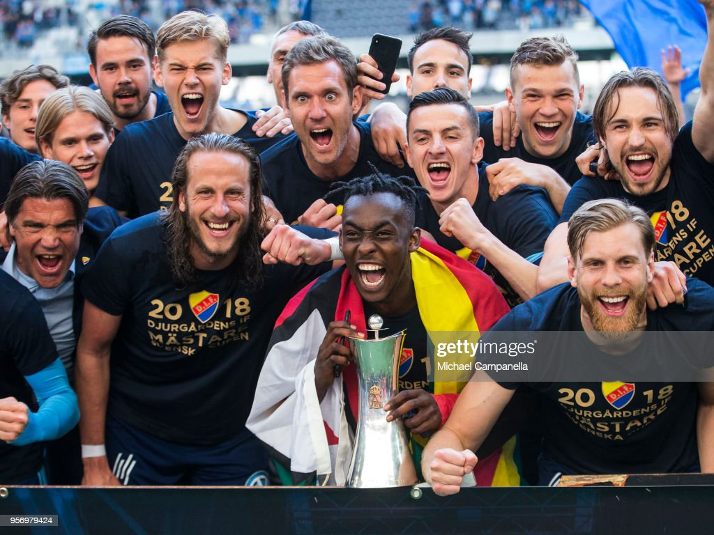 Tinotenda Kadawere holds the Swedish Cup trophy and poses for pictures with teammates after winning the Svenska Cupen Final between Djurgardens IF and Malmo FF at Tele2 Arena on May 10, 2018 in Stockholm, Sweden.