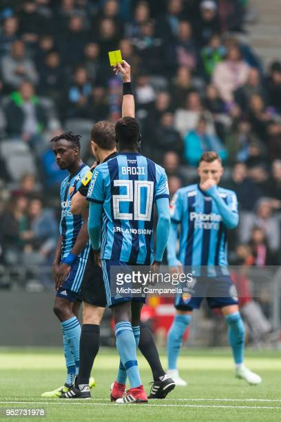 Tinotenda Kadawere receives a yellow card during a match between Djurgardens IF and Hammarby IF at Tele2 Arena on April 29 2018 in Stockholm Sweden