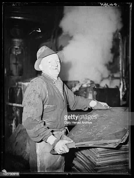 Tinplate worker 1940 A photograph of a laughing tinplate worker in a South Wales factory taken by Harold Tomlin for the Daily Herald newspaper on 28...