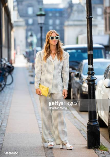Tinre Kjaer is seen wearing plaid blazer and pants outside Helmstedt during Copenhagen Fashion Week Spring/Summer 2020 on August 07, 2019 in...