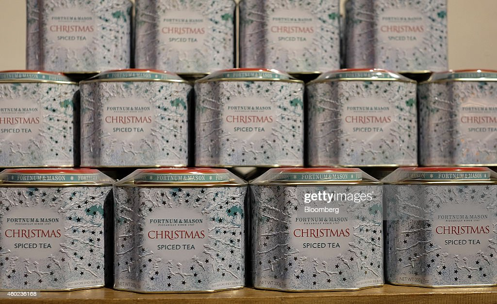 Tins of Christmas spiced tea sit on display inside a pop-up store, operated by Fortnum & Mason Plc, during a seasonal Christmas event at Somerset House in London, U.K., on Tuesday, Dec. 9, 2014. The British will be the biggest spenders in Europe on Christmas gifts this year, according to a study commissioned by Dutch bank ING Groep NV. Photographer: Simon Dawson/Bloomberg via Getty Images