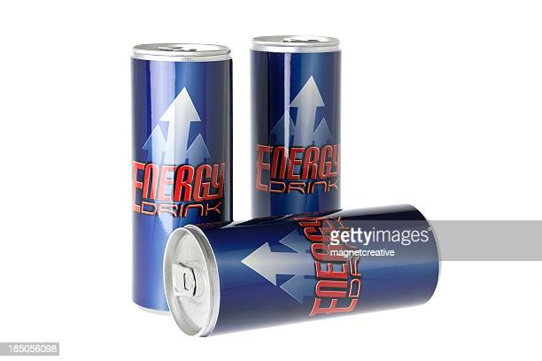 3 tins of energy drink - two upright and one laid down