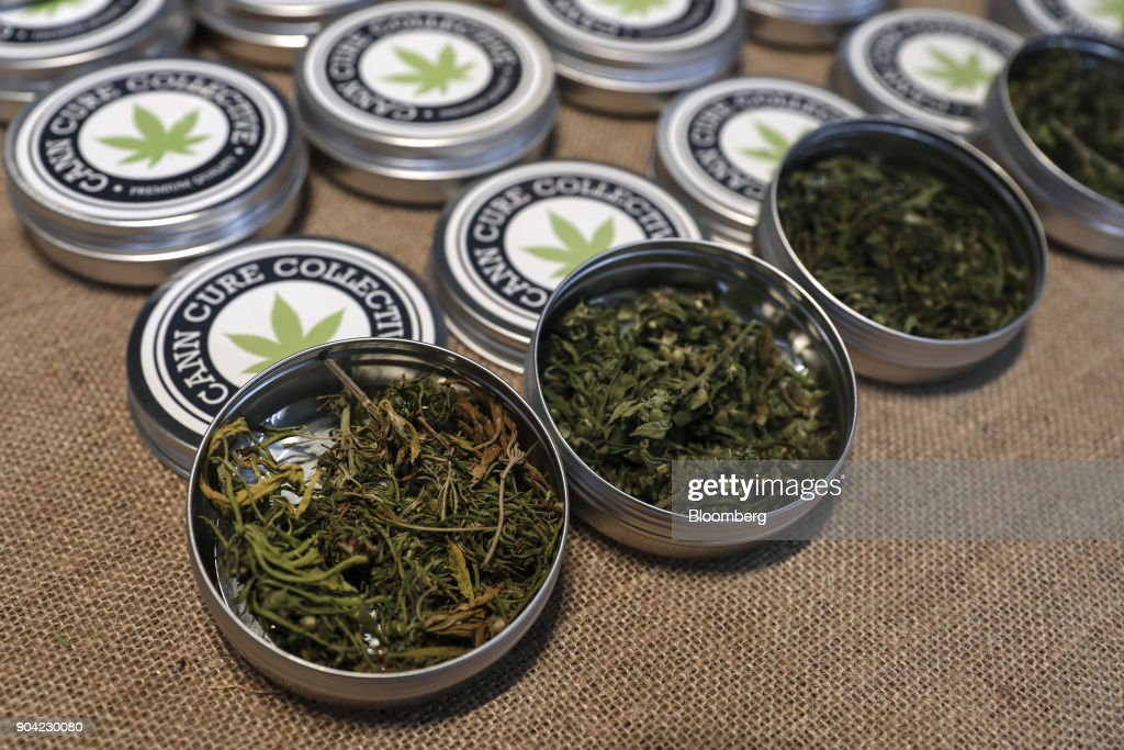 Tins of marijuana leaves from the Cann Cure Collective sit on display at the 1st International Cannabis Expo at the Faliro Sports Pavilion in Athens, Greece, on Friday, Jan. 12, 2018. The purpose of the event is to inform the public about all the products and innovations that exist in the world of cannabis and the latest achievements in the medical, pharmaceutical and industrial use of cannabis. Photographer: Yorgos Karahalis/Bloomberg via Getty Images